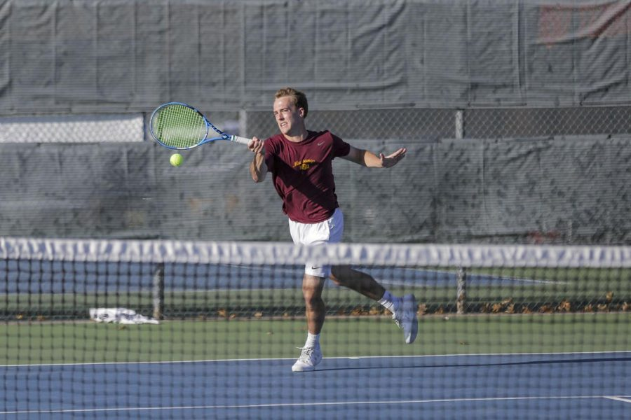freshman Brice Bradshaw returns with a forehand