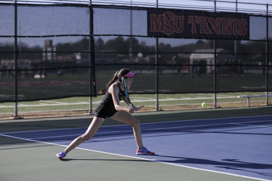 Pre-med freshman Emilija Visic goes in for a steady forehand to return