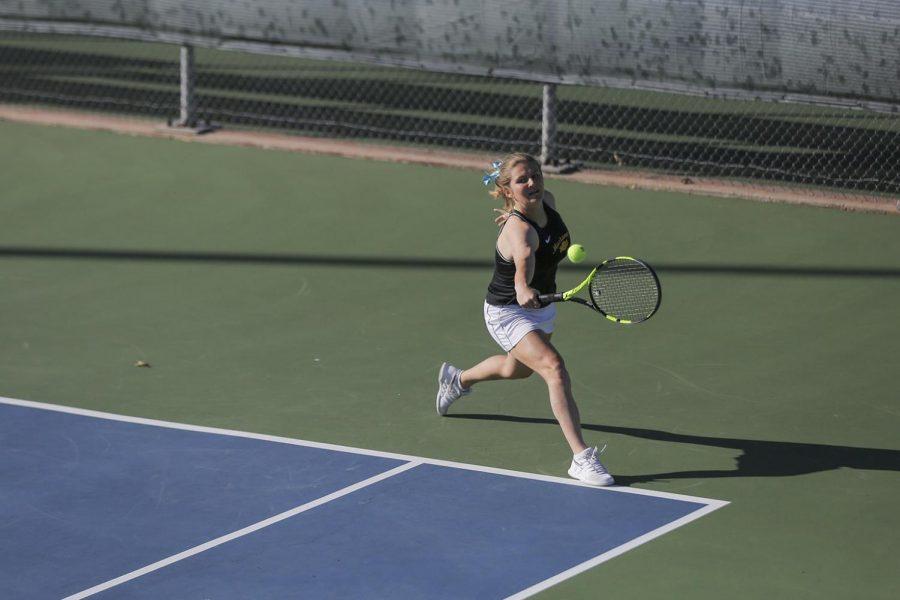 Senior Juliette Mary reaches for a corner shot