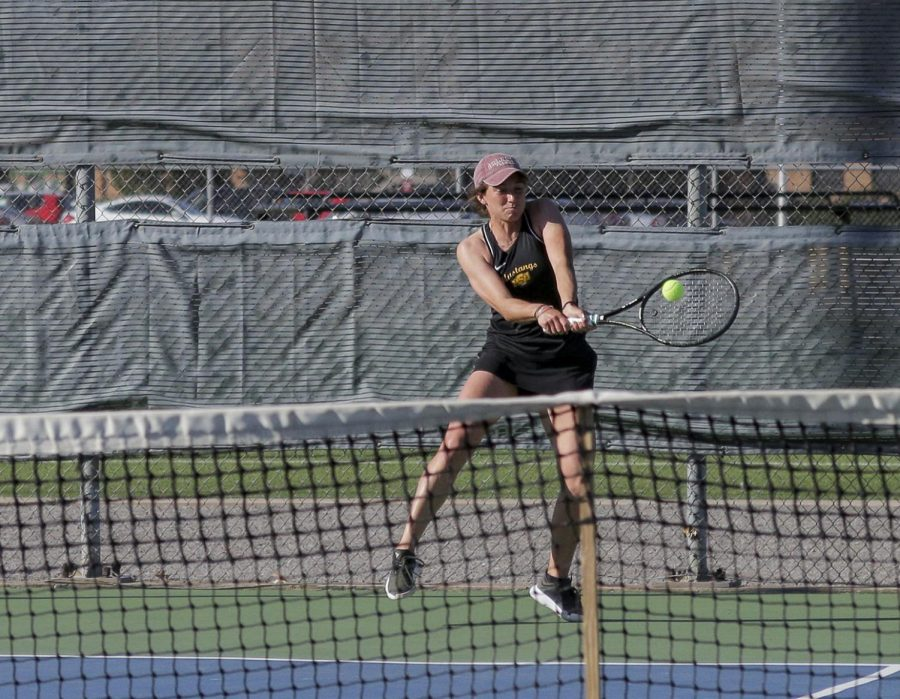 Lea Cizeron returns with a two-handed backhand
