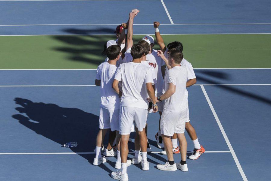The men's tennis team hypes itself up