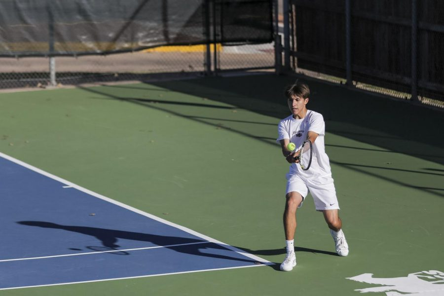 Quentin Scharfenberg returns with a two-handed backhand