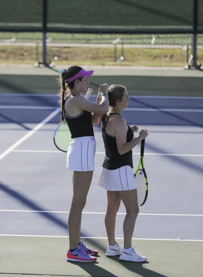 Pre-med freshman Emilija Visic fixes senior Juliette Mary's bow