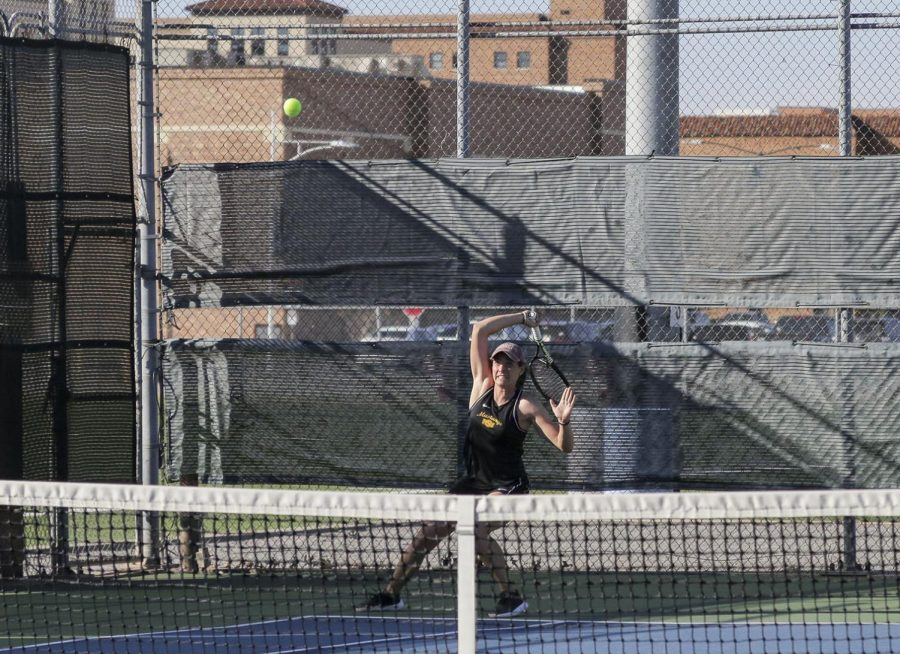 Global studies senior Lea Cizeron returns with a forehand