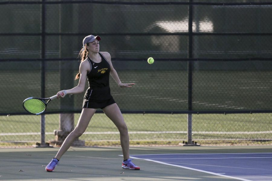 Pre-med freshman Emilija Visic lines up a forehand in her singles match