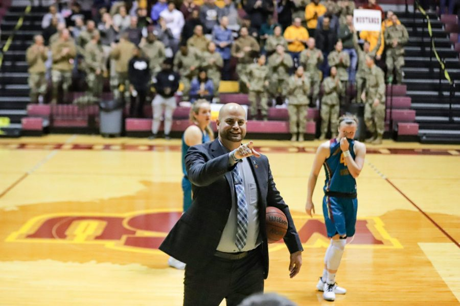 Head coach Chris Reay points to the crowd in celebration. Feb. 15.
