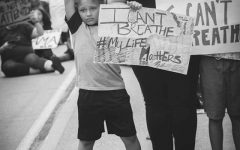 Jordan, 7, raises his fist in the air at the Wichita Falls #icantbreathe protest. June 1. Photo by Katie Bindel