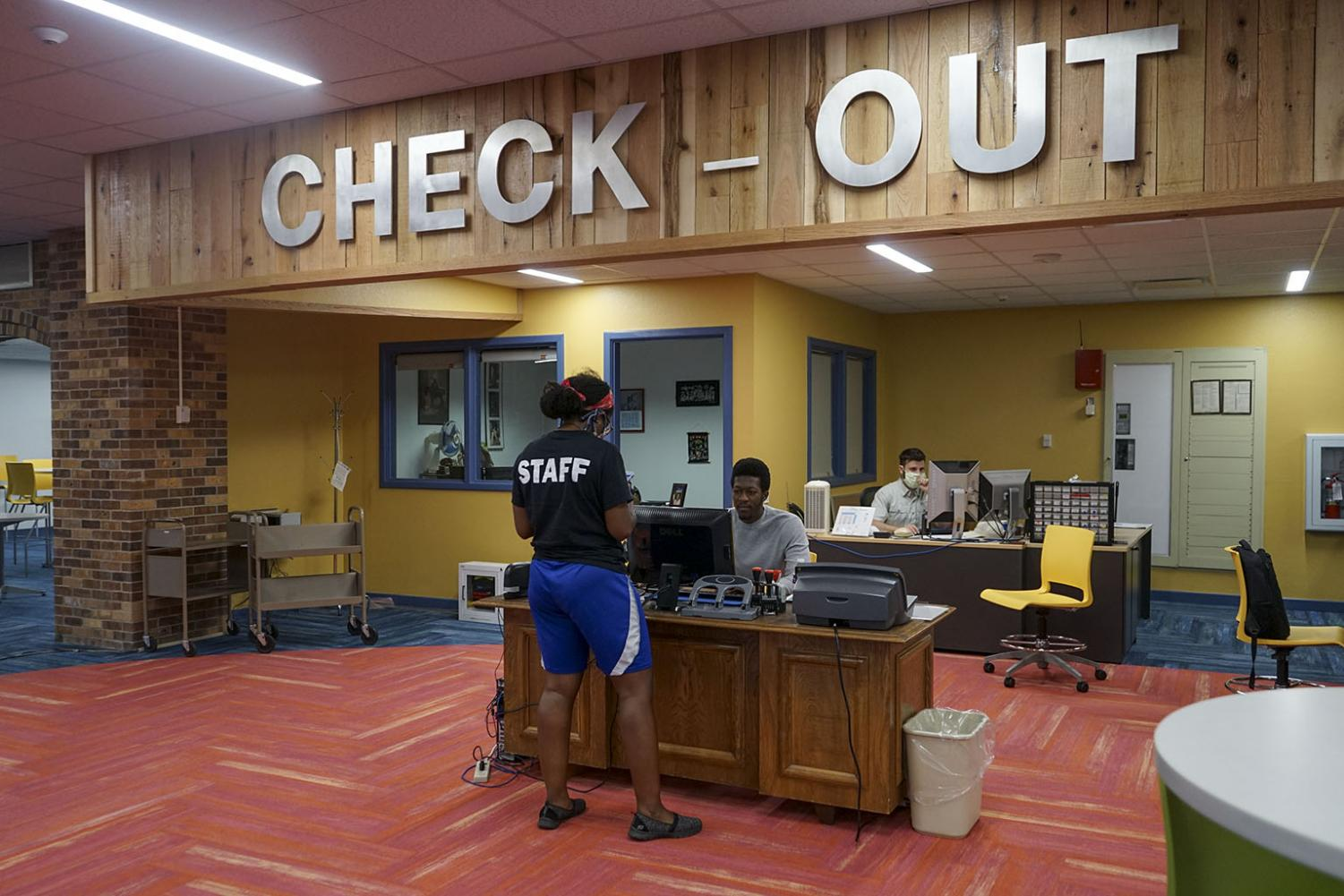A student checks out a book at the renovated library