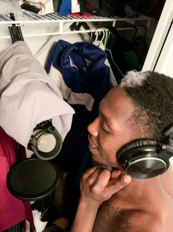 Applied arts and sciences junior and basketball guard Terrell Wilson records in his closet, March 25.