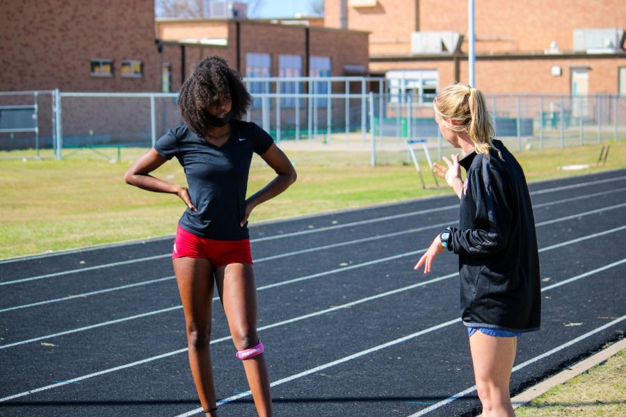 Track coach Kelsey Bruce, gives one of her athletes pointers on running form