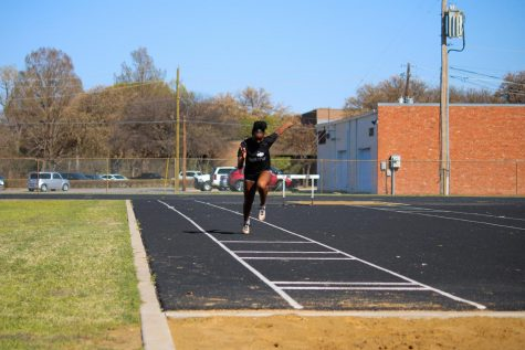 Finance sophmore, Peyton Lewis, practices long jump in an effort to futher her abilities.