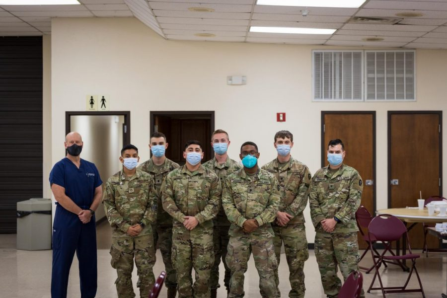 Keith Williamson pictured with soldiers during the COVID-19 vaccine clinic at the Sikes Lake Center, April 8.