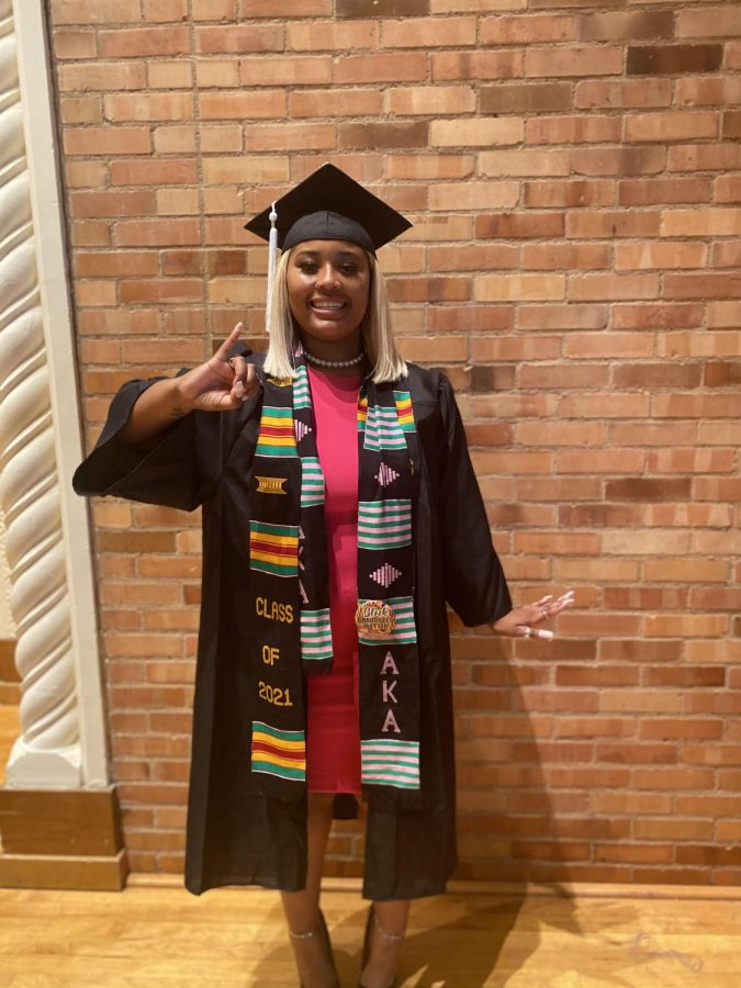 Shakore Lewis graduates with a bachelor of arts in political science along with a minor in criminal justice, April 30.
