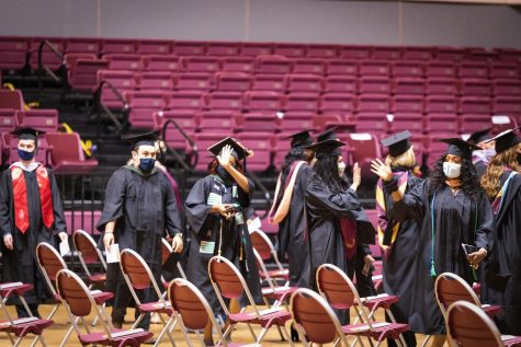 MSU graduate students greet the crowd before the graduation ceremony begins, April 30.