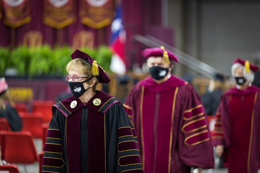 MSU president, Dr. Shipley, exits the building following the graduation ceremony, May 1.