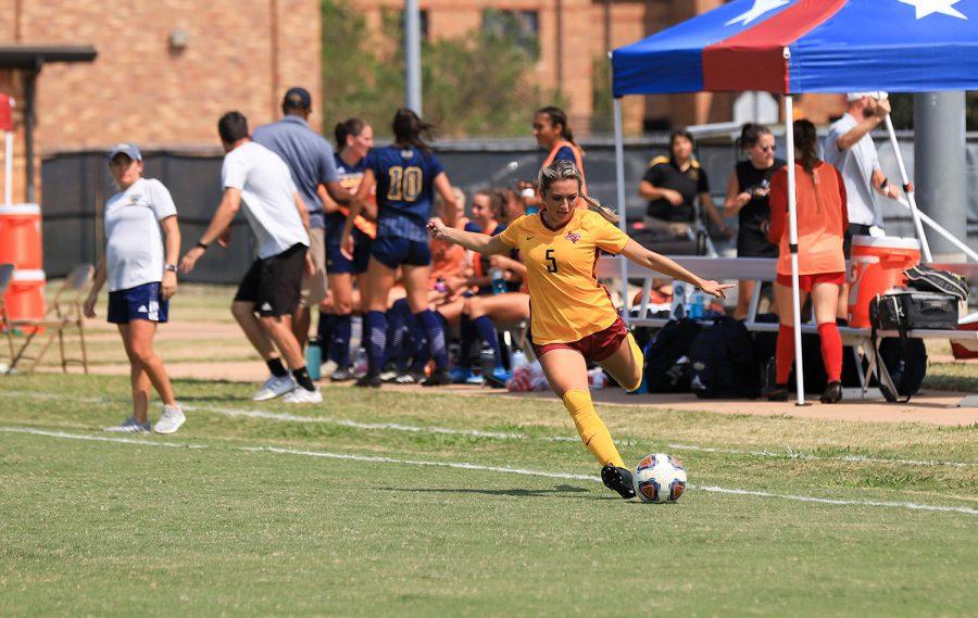 Biology junior and midfielder Alyssa Salinas passes the ball to her teammates downfield.