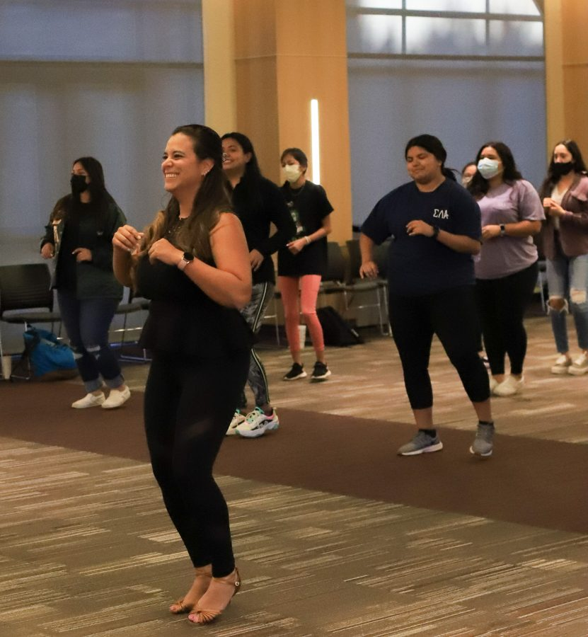 Instructor Keyla Ahow demonstrates the basic 8 counts of Bachata