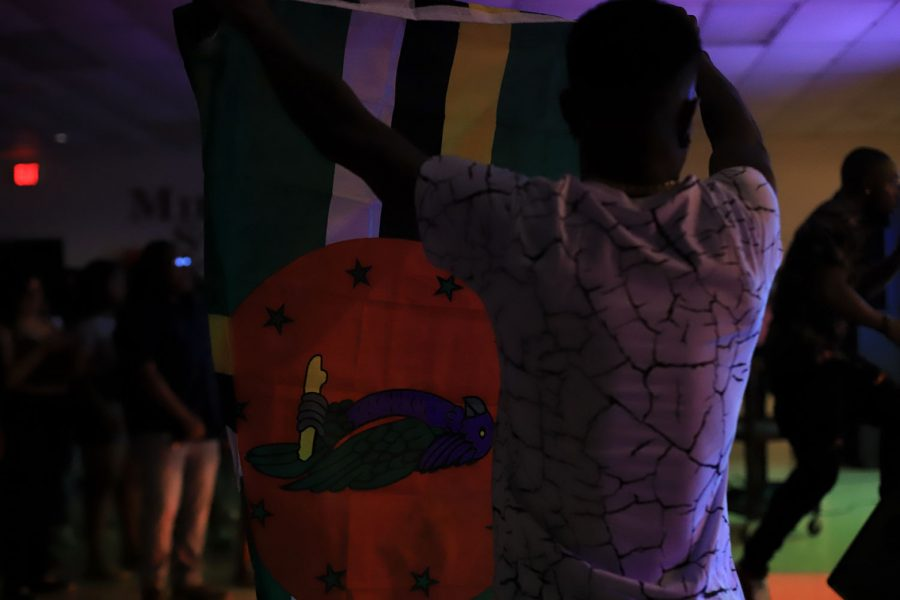 Krim holds up the Dominican Flag during Esco Levis performance.