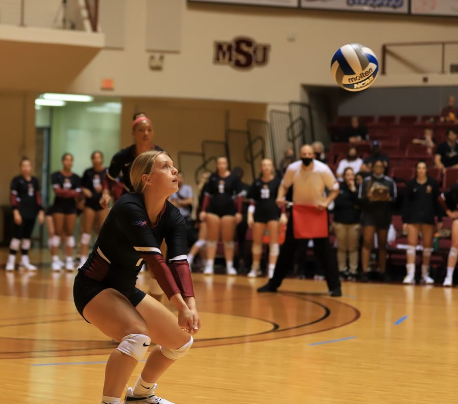 Business freshman and setter Regan Williams passes the ball from a tap off the block