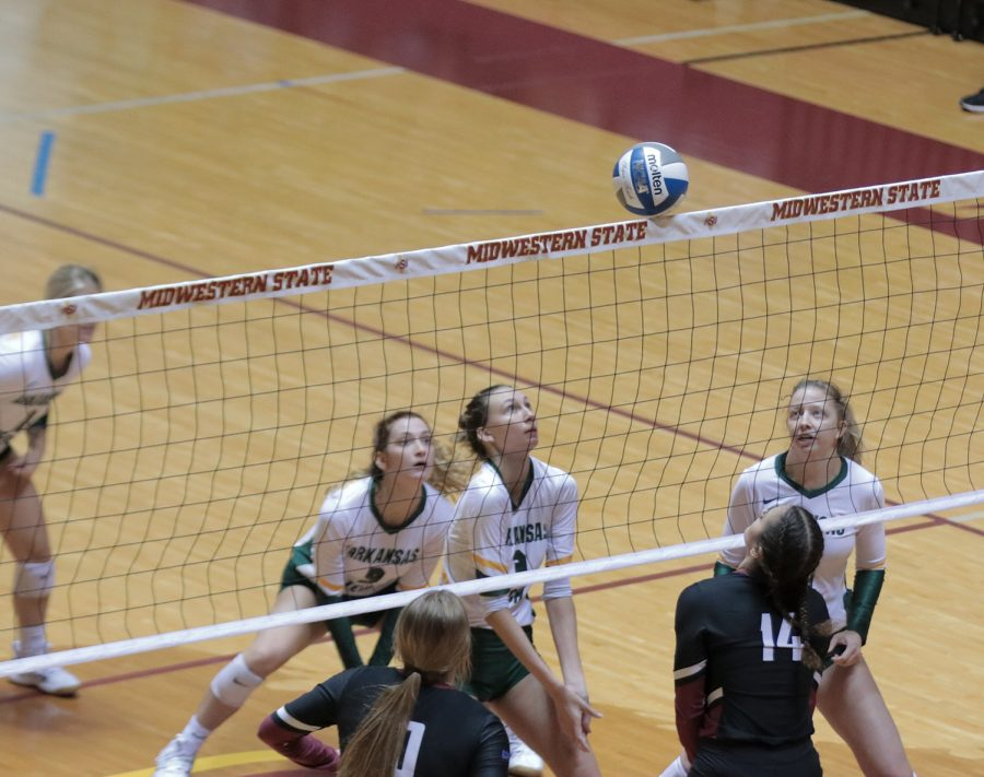 Nursing freshman and outside hitter Kelli Ell, pre-law senior and middle blocker Lissette Lefforge and Mass communication senior and outside hitter Taylor Anderson ready for the ball to fall off of the net
