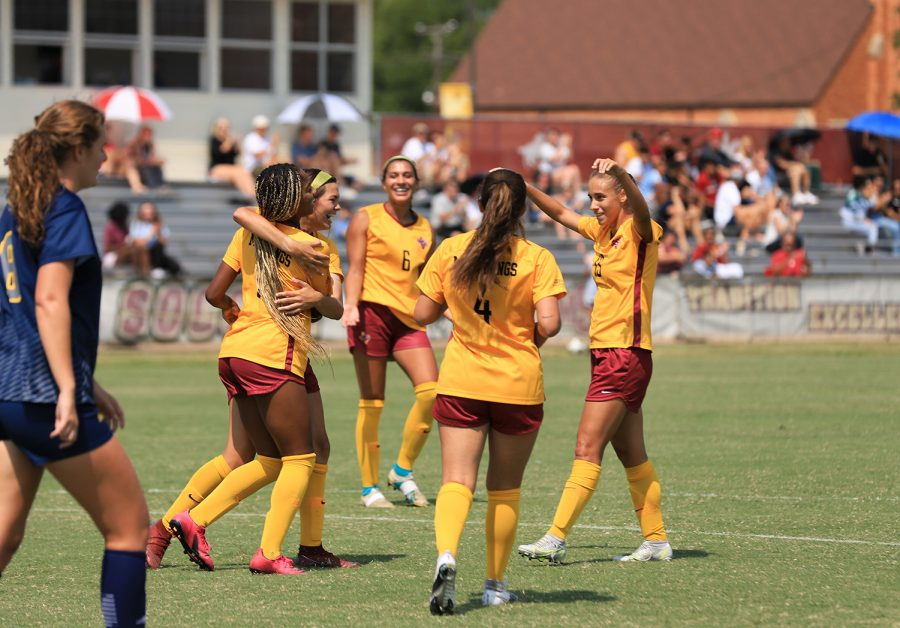 After scoring a goal, the Mustangs come together to celebrate