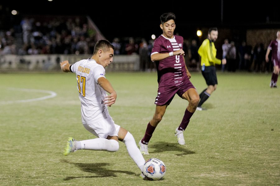 Kinesiology senior and midfielder Carlos Flores winds up for a kick to send the ball closer to West Texas A&Ms goal in the second half