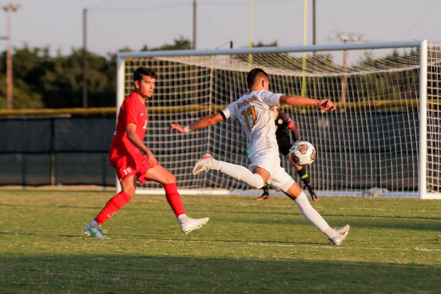 Kinesiology senior and midfielder Carlos Flores winds up for an attempt on Simon Frasers goal.