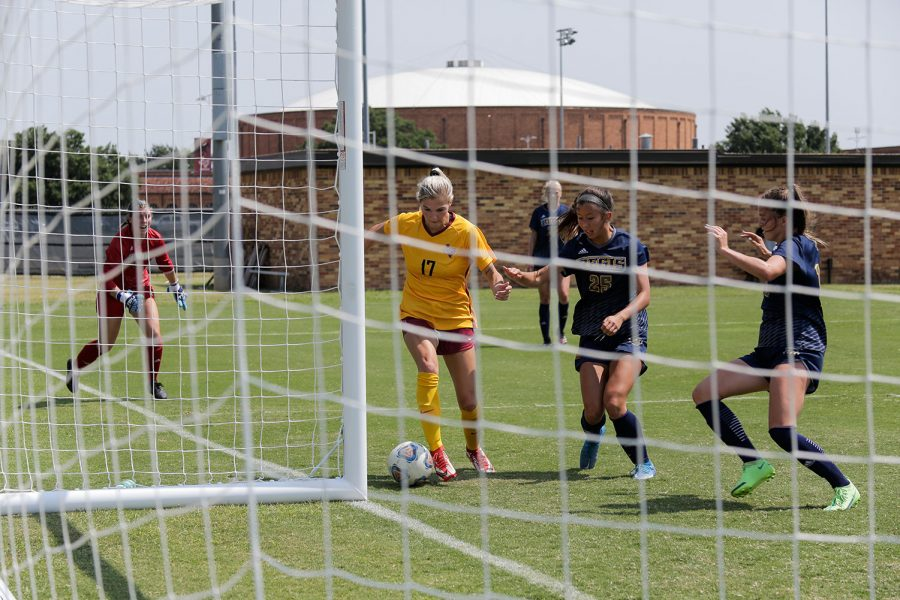 Psychology sophomore and forward Cassidy Savoy attempts a goal after the opposing goalie had blocked the ball and put herself out of position