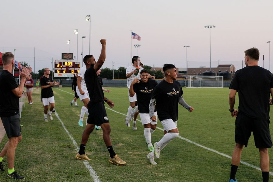 The stangs and their coaches celebrate a goal against Northeastern State