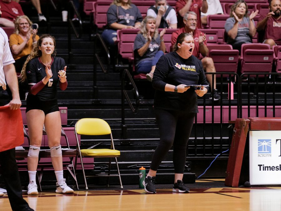 Head coach Valerie Armstrong shouts on her players during their match against Arkansas Tech.