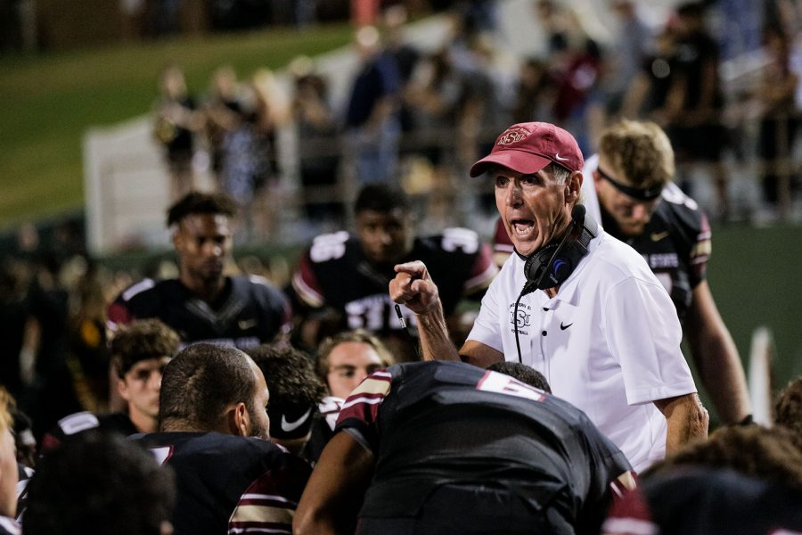 Head coach Bill Maskill talks to his team after the game