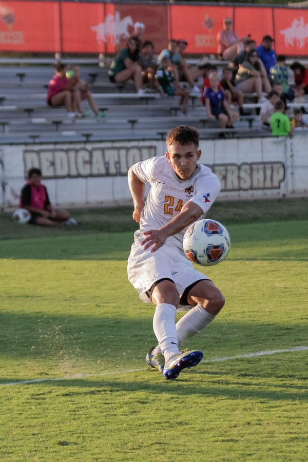 Exercise physiology and midfielder Colby Parton uses a strong kick to send the ball to his teammates closer to Simon Frasers goal.