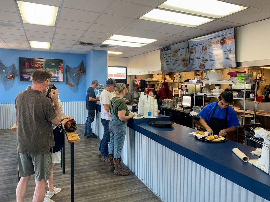 People line up at the counter to order at The Catch.