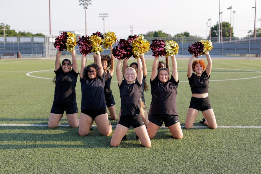 Social work senior Alicia Phinney leads the dance team during a practice
