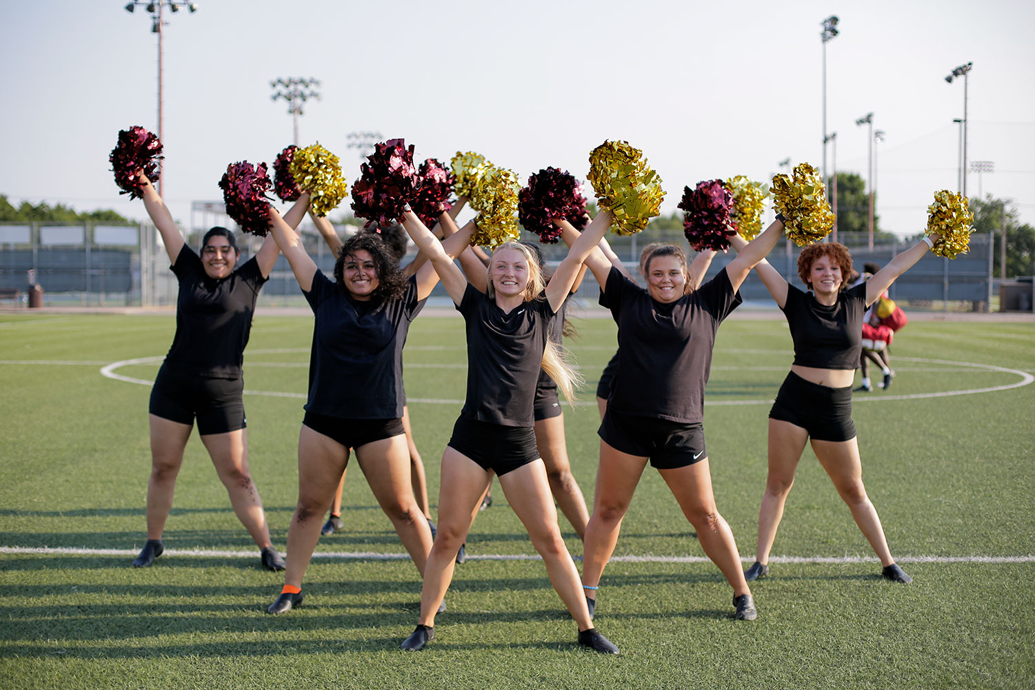 The dance team works on its routine during a cool afternoon