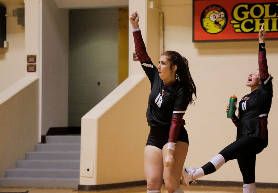 Education freshman and defensive specialist Delaney Torres and sports and leisure studies sophomore Autumn Roach celebrate a point by their team