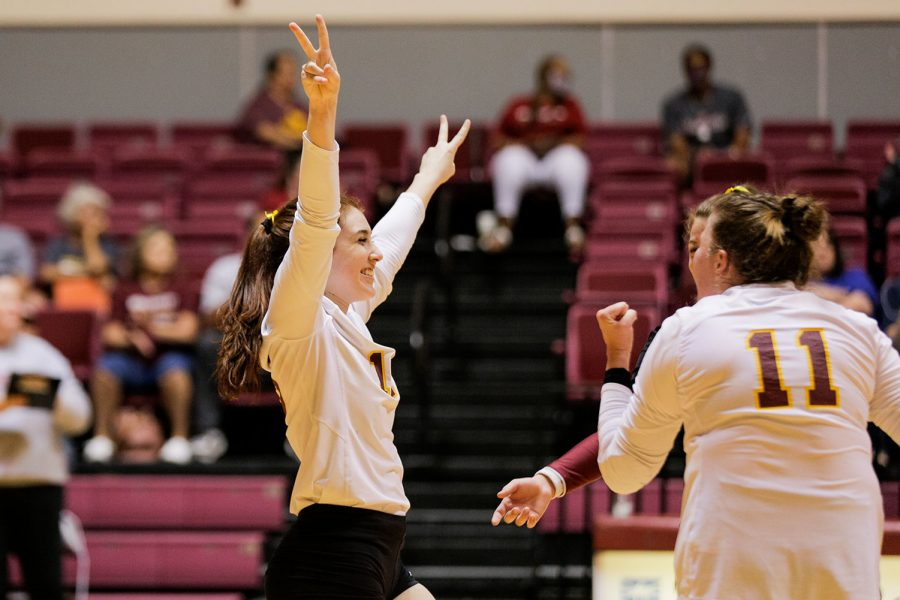 Education freshman and defensive specialist Delaney Torres walks towards her teammates as they all celebrate a won point
