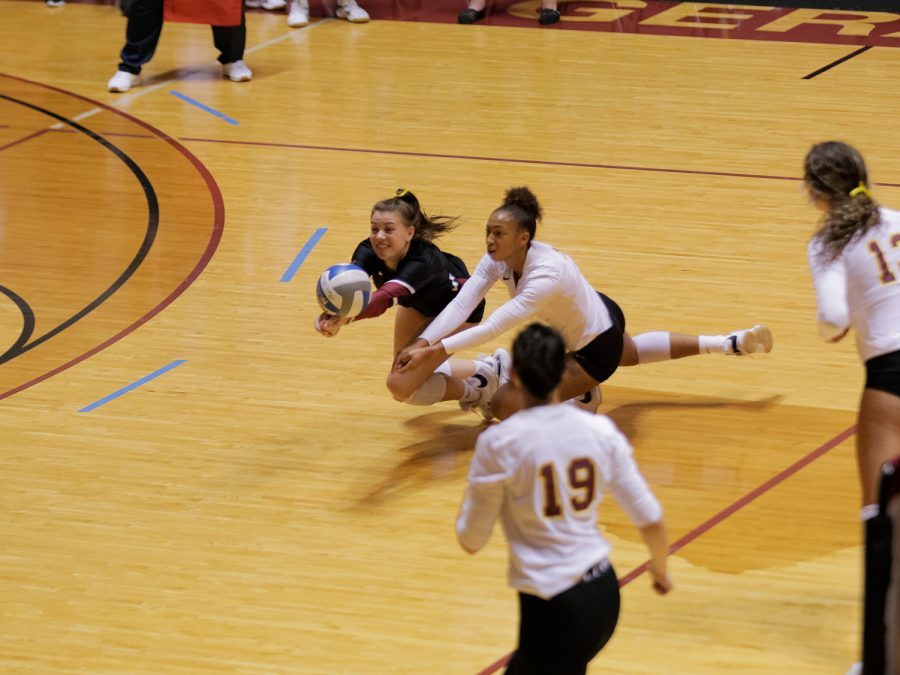 Undecided freshman and libero Amy Dewalt and chemistry sophomore and outside hitter Lauryn Bourne both dive for a dig
