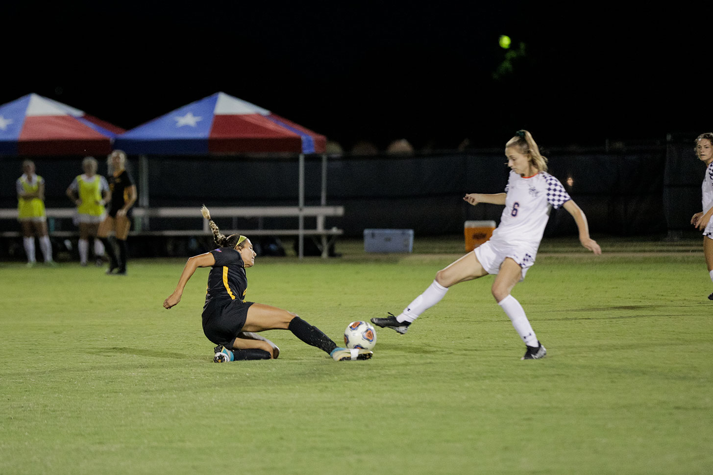 Sport and leisure studies senior and defender Hayden Zuniga slides to kick the ball out from under the foot of a Mines player