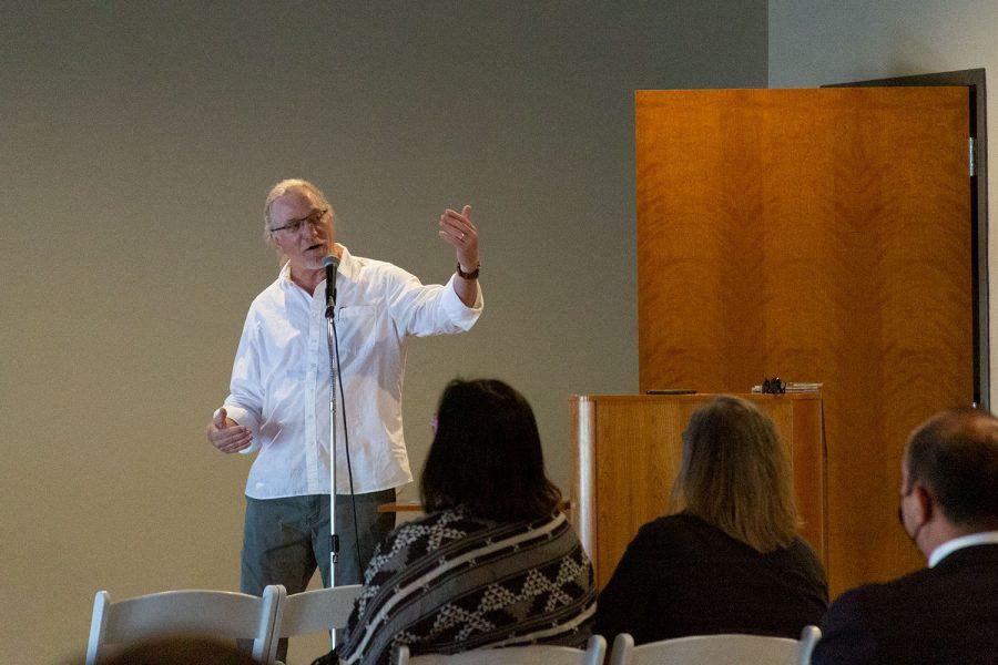 Faculty advisor John Schulze introduces the Voices release party