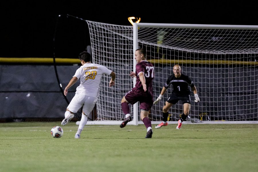 Kinesiology senior and midfielder Julian Barajas makes an attempt on West Texas A&Ms goal