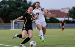 Radiology senior and midfielder Kelly Cannistra keeps the ball on the field despite pressure from a Mines player
