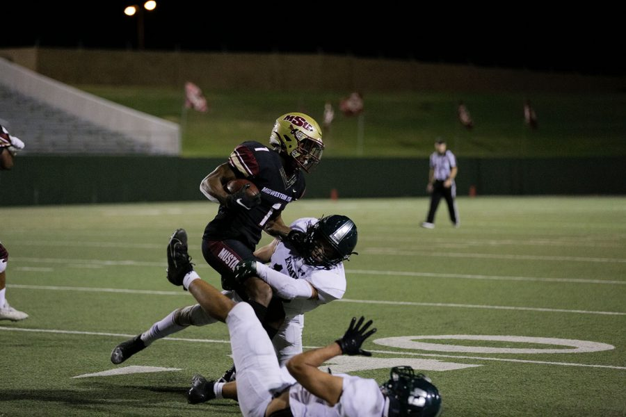 Kinesiology senior and running back KVonte Jackson pushes past opposition from Eastern New Mexico