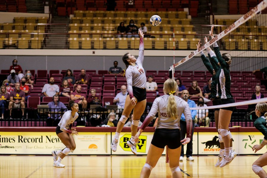 Pre-law senior and middle blocker Lissette Leforge jumps for an attack on Eastern New Mexico