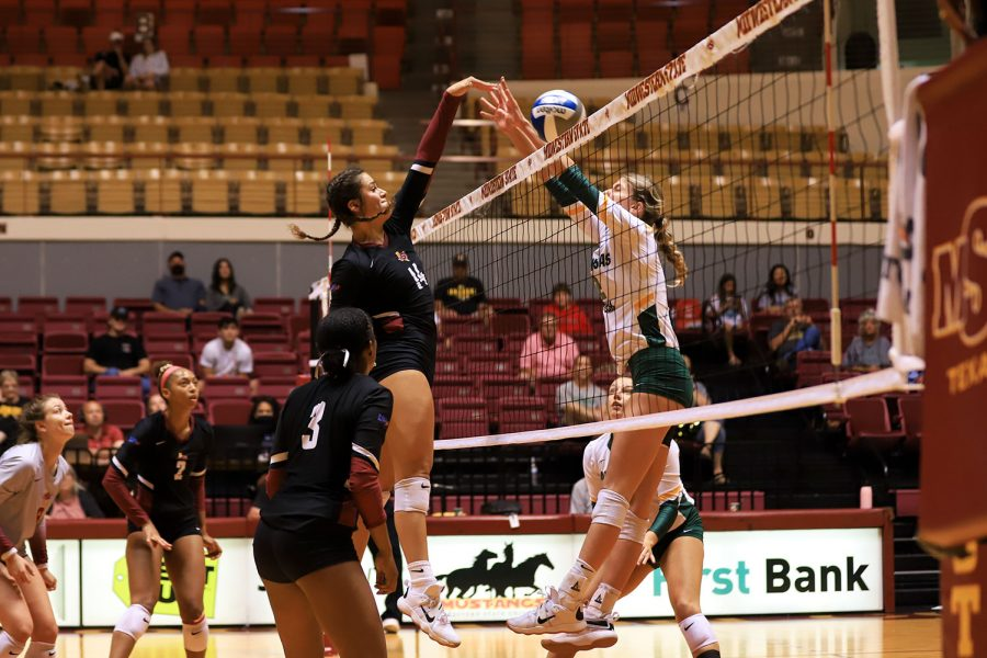 Pre-law senior and middle blocker Lissette Lefforge spikes the ball past a block put by Arkansas Tech