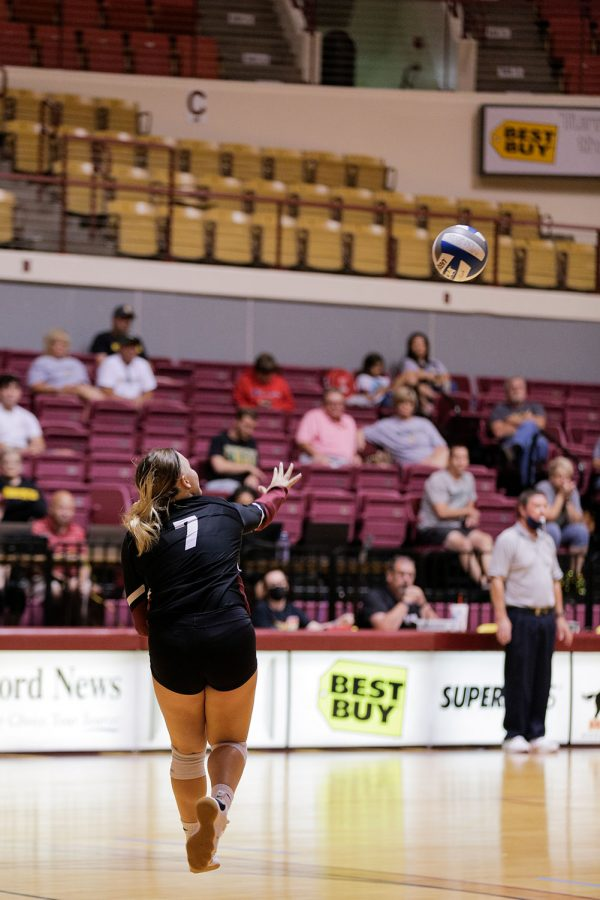 Undecided freshman and defensive specialist Madison Becker serves in the fifth set