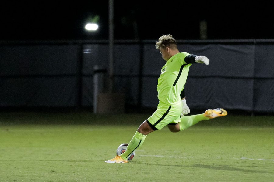 Marketing senior and goalkeeper Marc-Antoine Huzen winds up for a strong kick across the field