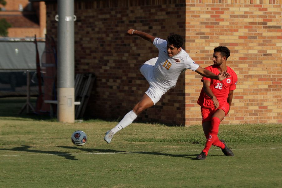 Undecided sophomore and forward Max Gonzales leaps to try to keep the ball away from a Simon Fraser player.