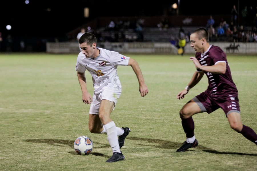 Exercise physiology sophomore and midfielder Rory Doyle works to keep the ball away from a West Texas A&M player during the second half