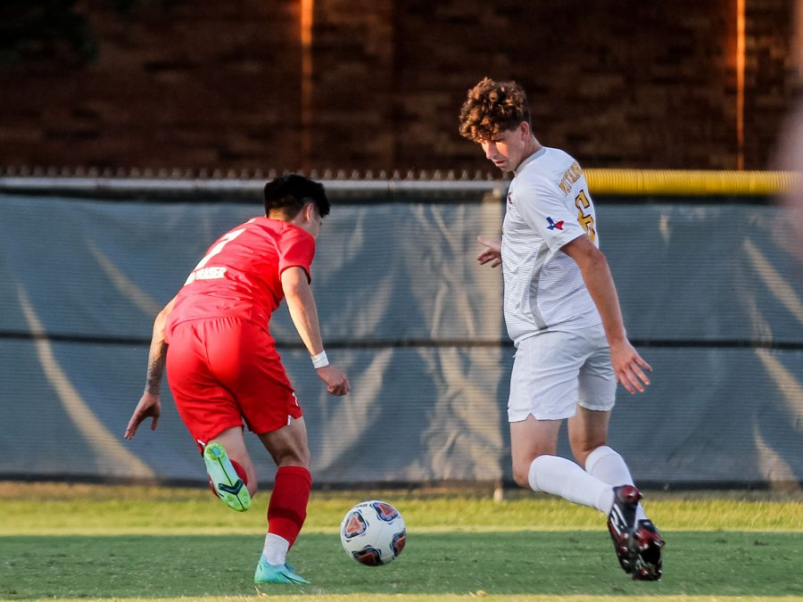 Sport and leisure studies senior and defender Rory OKeeffe faces off against a Simon Fraser player, trying to keep him away from the goal.